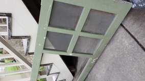 vintage green screen door in Oswego, New York